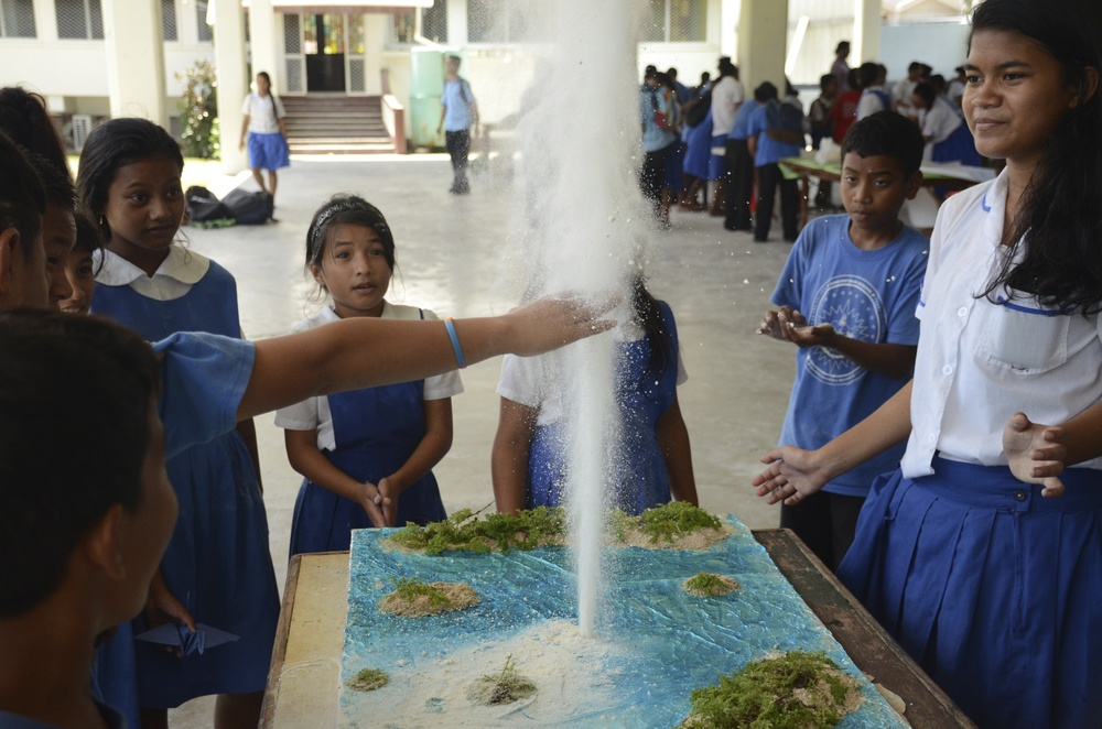 During a science fair, students use flour to simulate fallout.