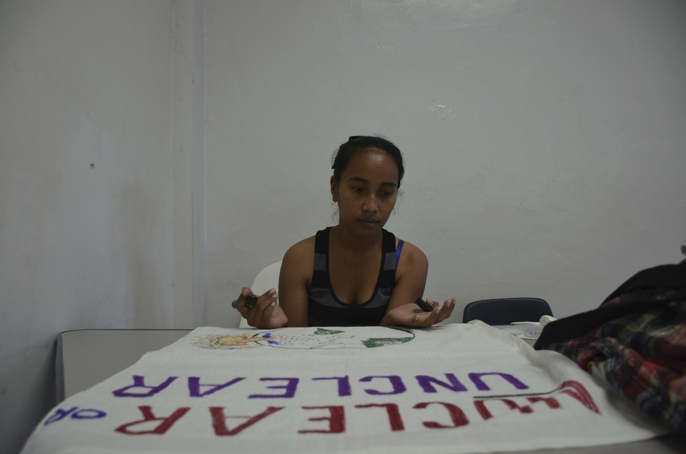 Suewellynn Johannes, a student at the College of the Marshall Islands, prepares a banner for Nuclear Victims Remembrance Day.
