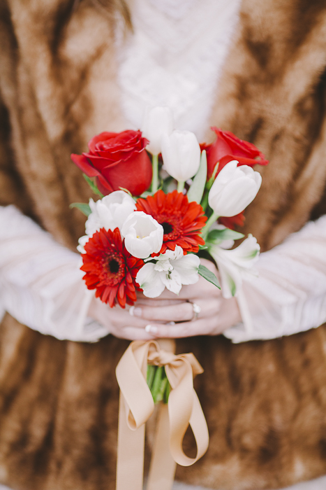 Woman holds a red and white bouquet - Sahara Coleman - Professional Wedding Photographer, Destination Photographer 2014 Seattle Washington