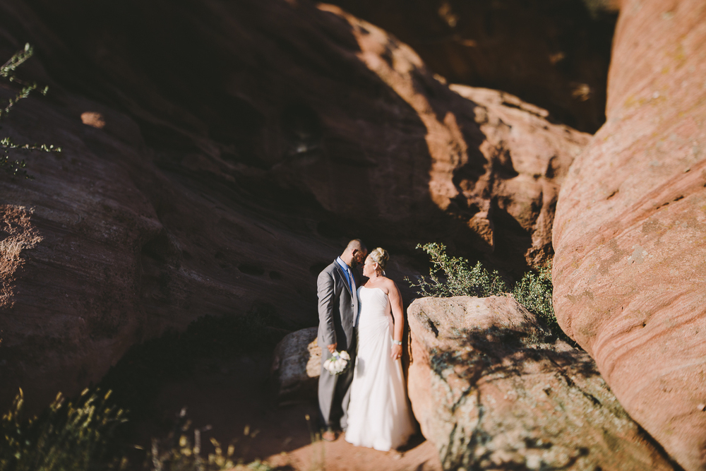 A couple on their wedding day stand at the base of a rocky canyon - Sahara Coleman - Destination Wedding Photographer, Seattle Washington