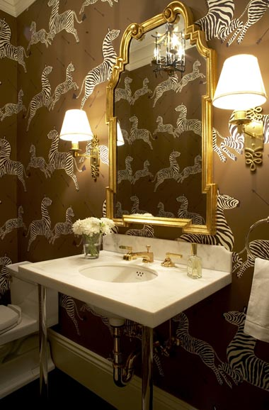 massucco warner miller powder room bathroom zebra herd wall paper brown black white gold frame mirror marble sink basin chrome plumbing fittings.jpg