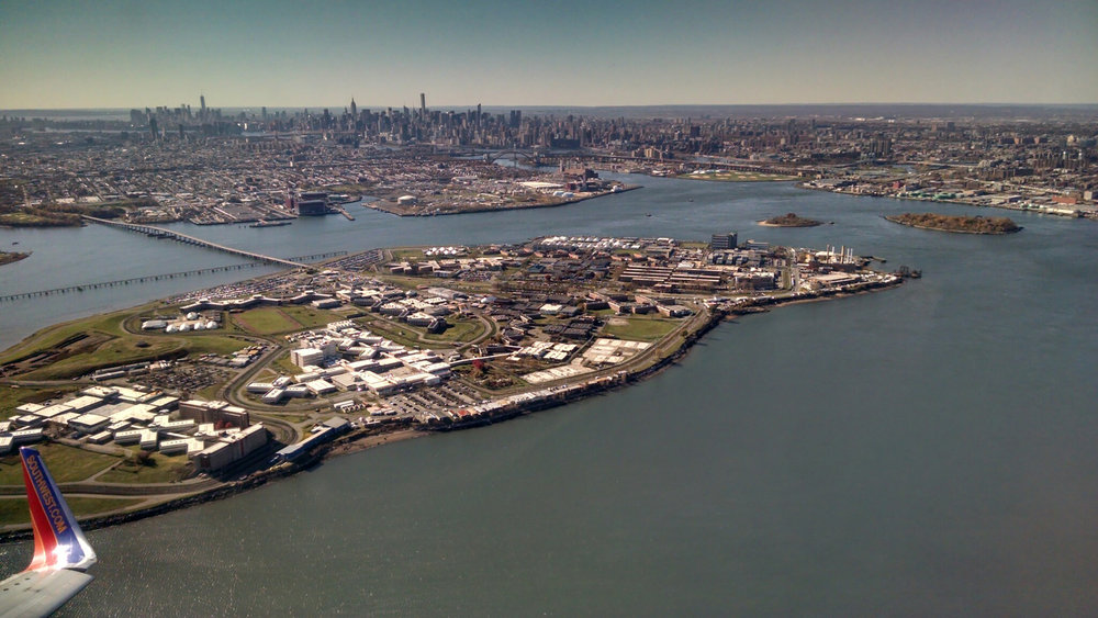 Rikers Island seen from a plane taking off at LaGuardia Airport. This image was used on promotional material for the exhibit.