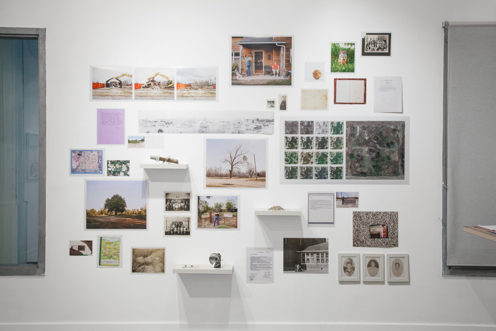 Treece Installation Shot. Wall with historical photographs, my photos, family snapshots, documents, letters and emails, bolt from Treece water tower, mining lamp, chat and more.