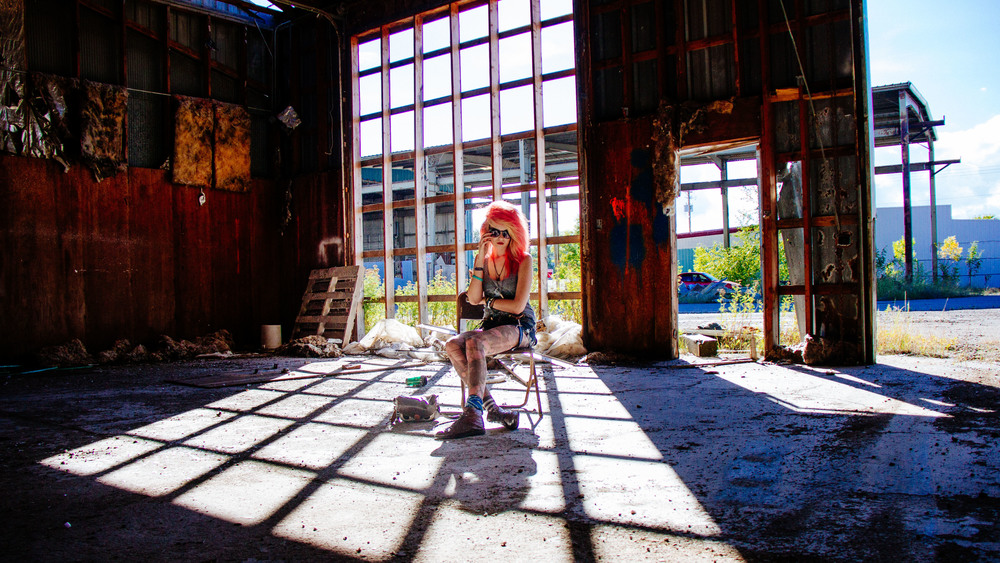 Girls Senior Portrait photo in an abandoned warehouse