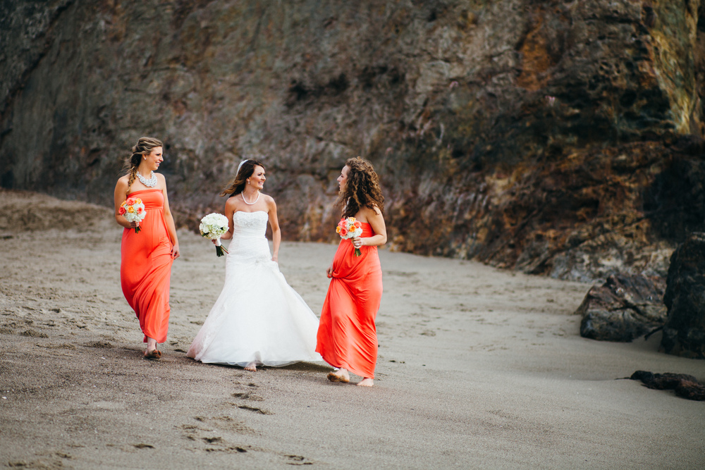 Wedding Photography. Bride walks down Point Dume beach with her bridesmaids. DIY Wedding