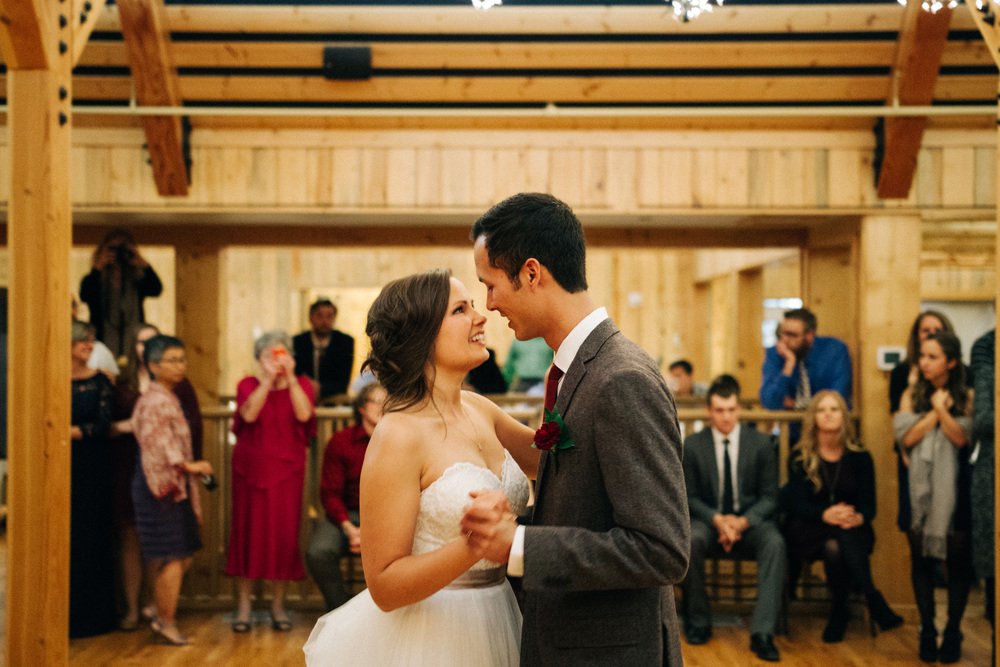 Wedding Photography. Bride and Groom share their first dance under the lights