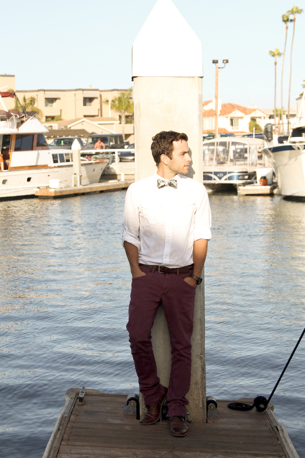 Once again, the white shirt is useful.  Notice how the red hues in Nick's pants are paired with the red hues in the bow tie.  It creates a visual connection, and the white shirt provides a backdrop.  For those wanting to wear a bow tie with pants of a different color, take a cue from this look.