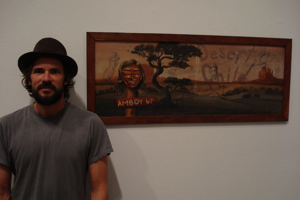 "Jay Schuette with his painting ""Desert Child"""