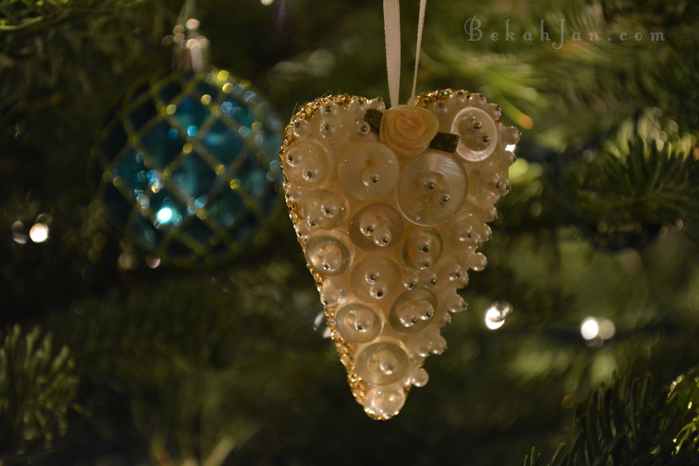 This heart ornament is covered in vintage buttons. For our family wedding reception, I handmade one for all the women and put them at their place setting.