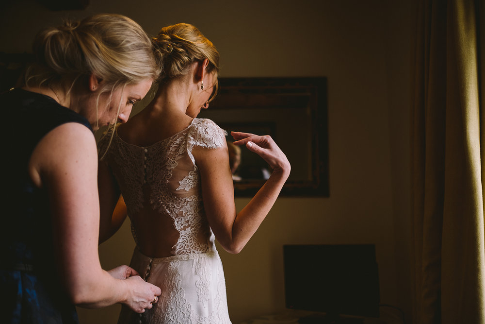 Bride putting her dress on