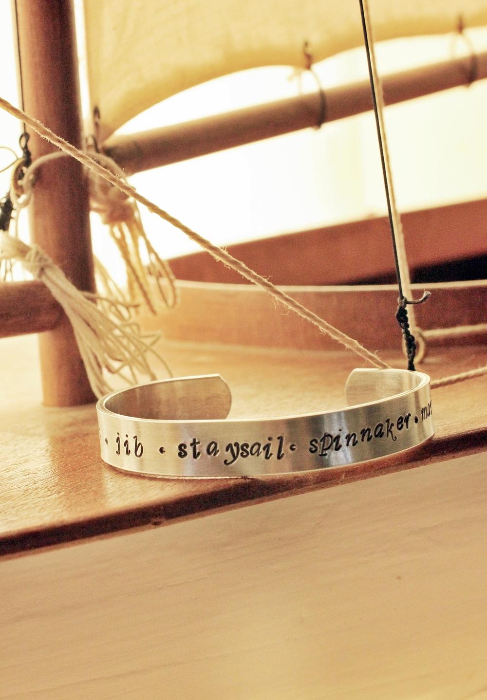 script sails metal cuff hand stamp bracelet by blue sail studios.JPG