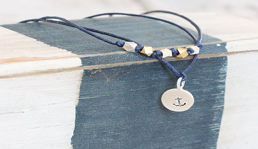 noelle wish bracelet paired with silver anchor bracelet blue sail studios jewelry.JPG