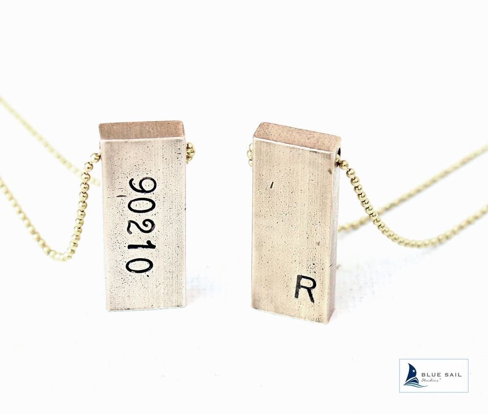 Ode Zip code necklace in raw brass