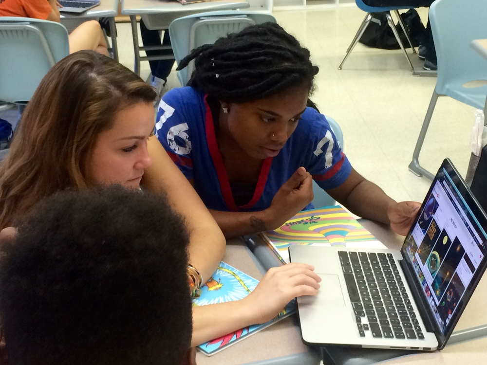 Ms. Moody authors looking at illustration ideas with Reach intern, Dominique