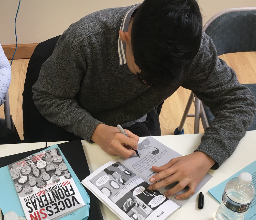 Alejandro signs book.JPG