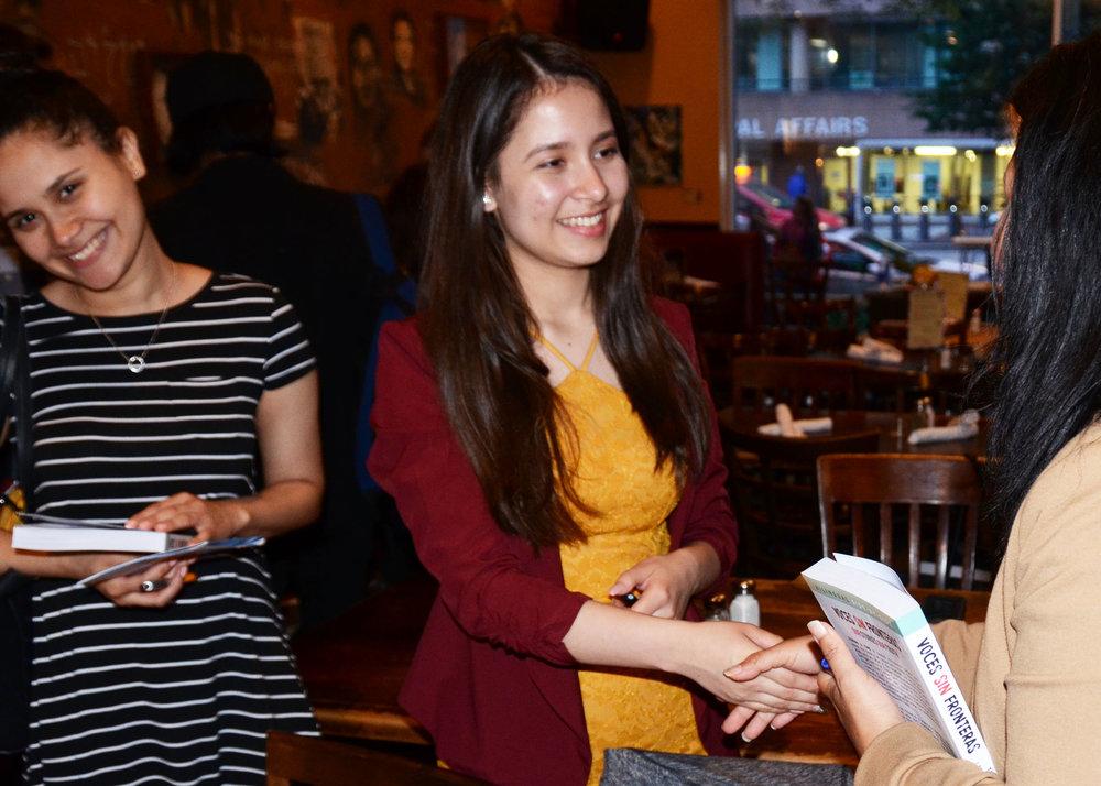 Andrea shakes hands w audience member (1).jpg