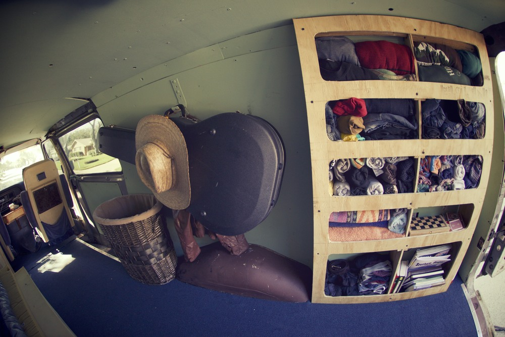 Starboard Interior. Dresser stuffed with clothes, games , reading material and the like. Guitar hanger, with other items and the laundry hamper