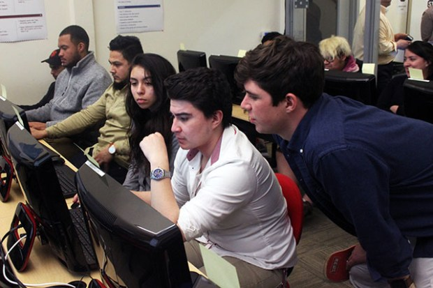 Students participated in the coding course held at Mission Economic Development Agency. Photo by Laura Waxmann, Mission Local.