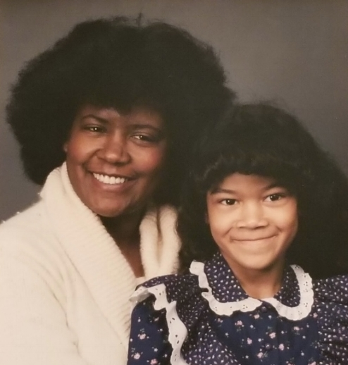 Sheena as a child, alongside her mother