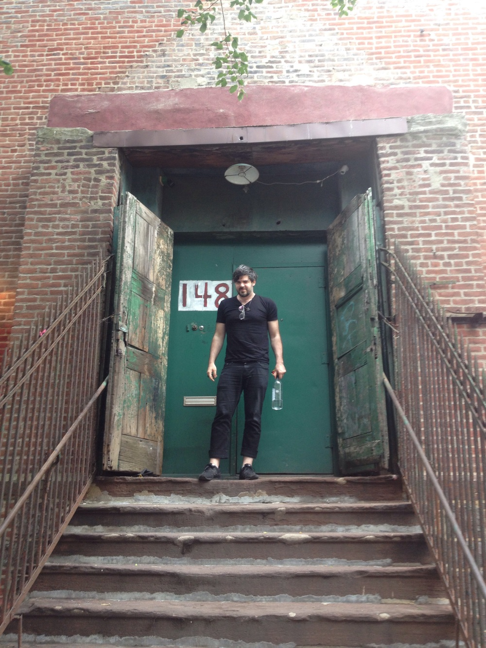 Zev outside his studio