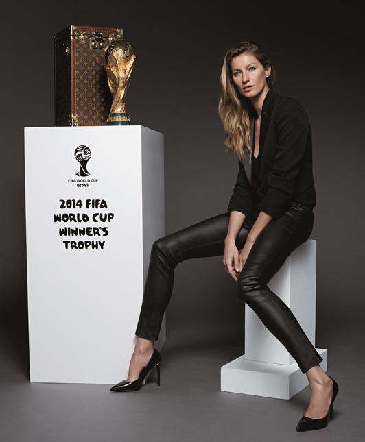 Gisele with the World Cup. Via www.telegraph.co.uk