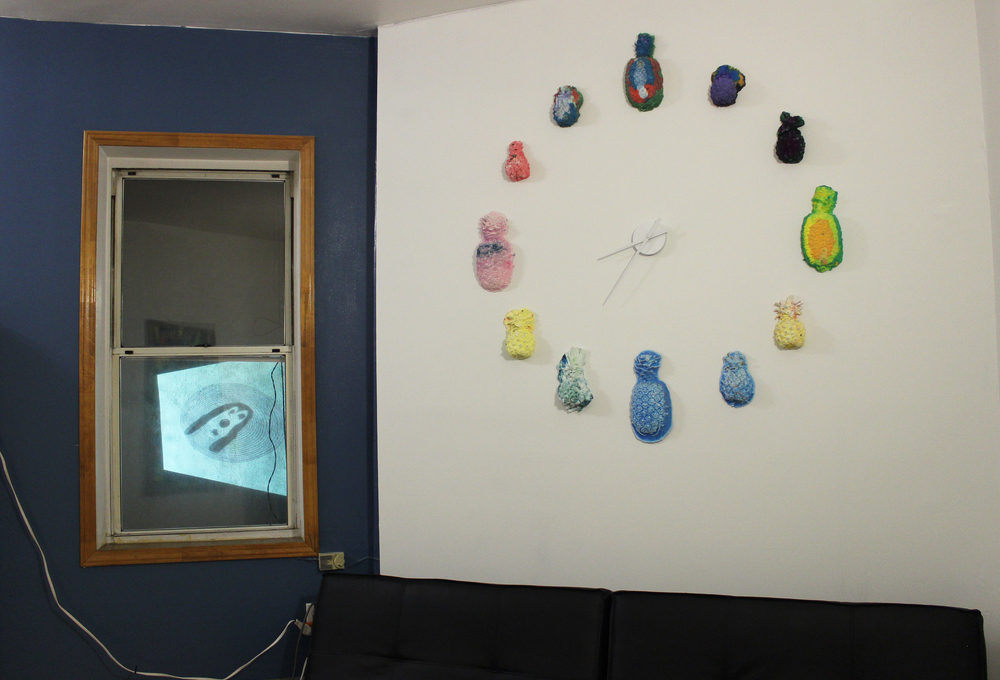 "left: Konsta Ojala,  Hessu , 2015, GIF file, continuous loop  right: Elizabeth Ferry,  Pineapple Clock , 2015, Hydrocal, pigment, 40""x40""x2"""