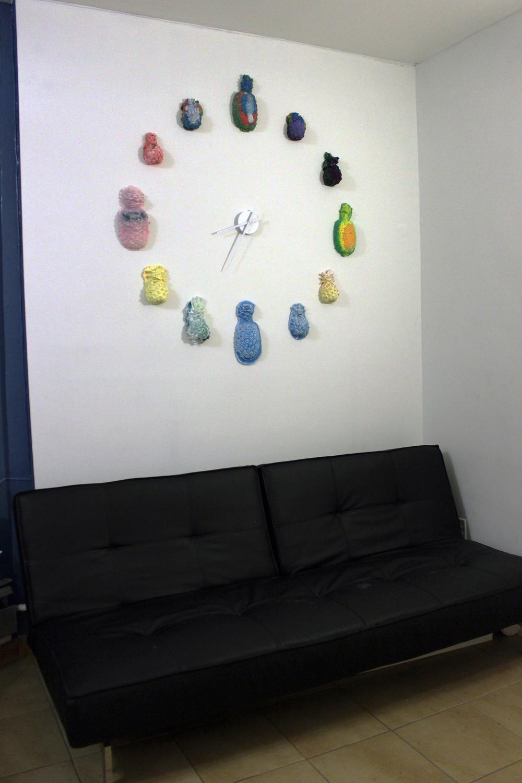 "Elizabeth Ferry, Pineapple Clock , 2015, Hydrocal, pigment, 40""x40""x2"""