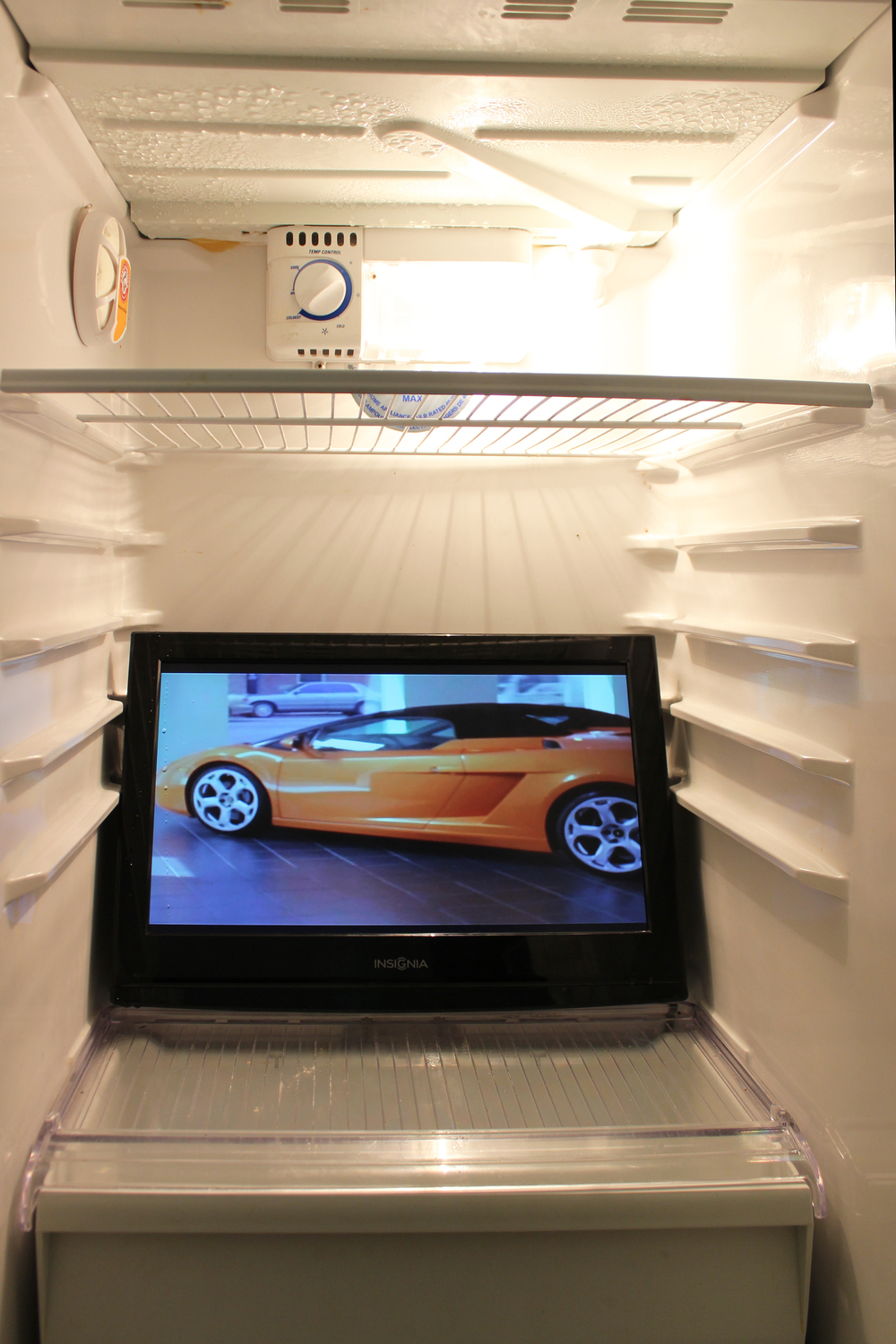 Ben Dowell,  2008 Lamborghini Gallardo (One Mind) , 2008, dvd, monitor, refrigerator, dimensions variable