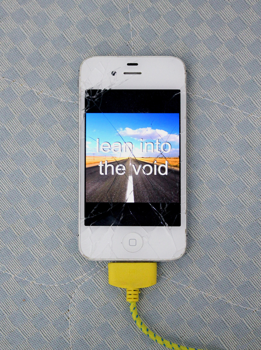 "lean into the void , 2015, iPhone, charger, video, 44"" x 2.5"" x .5"""