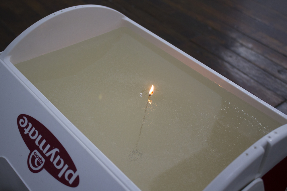 "In the beginning a flame, very pretty, often hot and fierce, but still only light and flickering (On the Go) , 2015, cooler, gel candle wax, wick, 12"" x 16"" x 15"""