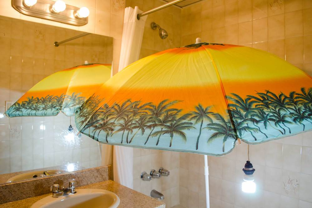 "Rain or Shine , 2015, beach umbrella, full spectrum daylight bulb, fixture, shower, 72"" x 72"" x 79"""
