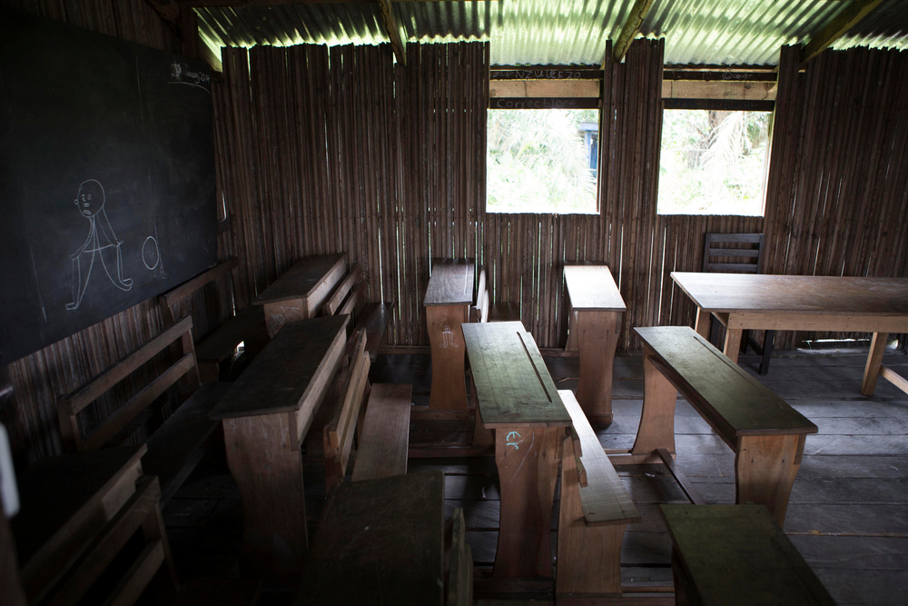 Classrooms look pretty cramped but I suspect in a small village like this the space is adequate. There are about 4-5 classrooms for primary education. They have to paddle into town for Junior High and Senior High School.
