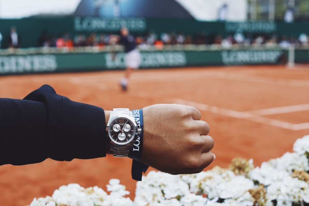 Time for a fun tennis match between tennis legends and young future legends. Sporting the Official  Longines Conquest Roland-Garros Watch