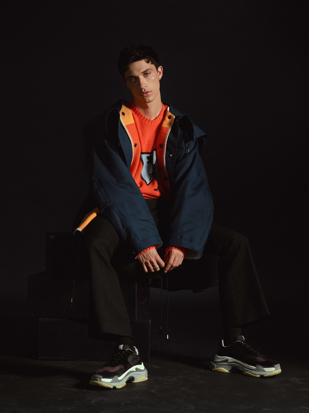 Calvin Klein 205W39NYC parka (fwrd.com), Prada sweater, Alexander Mcqueen pants, Balenciaga shoes