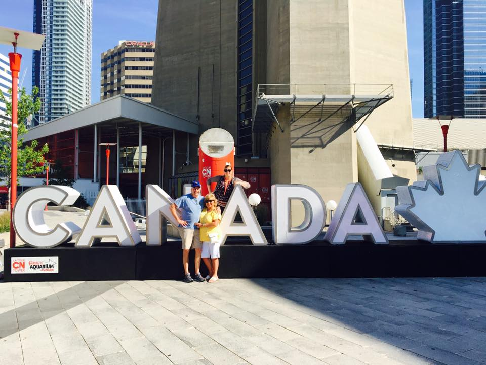 Truax and her parents in front of the CN Tower in Toronto, Ontario, Canada.