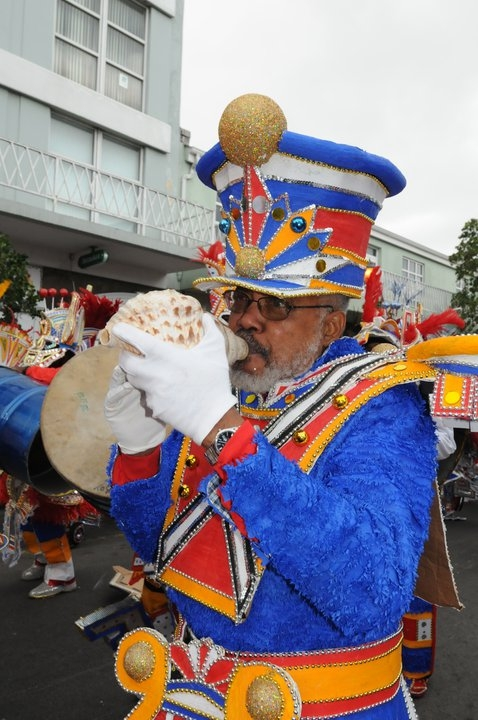 The late Jackson Burnside III blowing his conch shell with the One Family Horn Section at the Junkanoo parade on Bay Street, Nassau