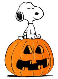 Snoopy sitting on scared pumpkin.jpeg