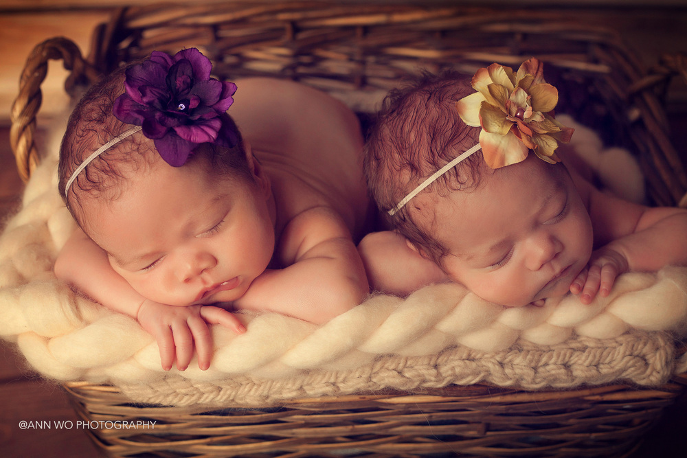 newborn photography session visit - twin sisters, london, using flower headbands