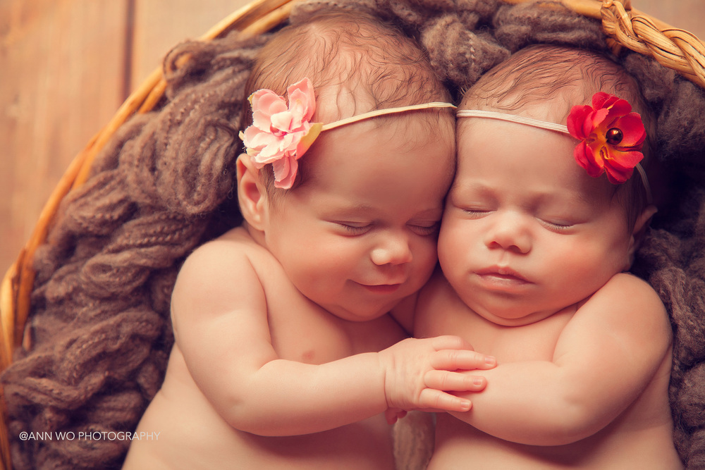 smiling newborn twins hugging - ann wo photography in London