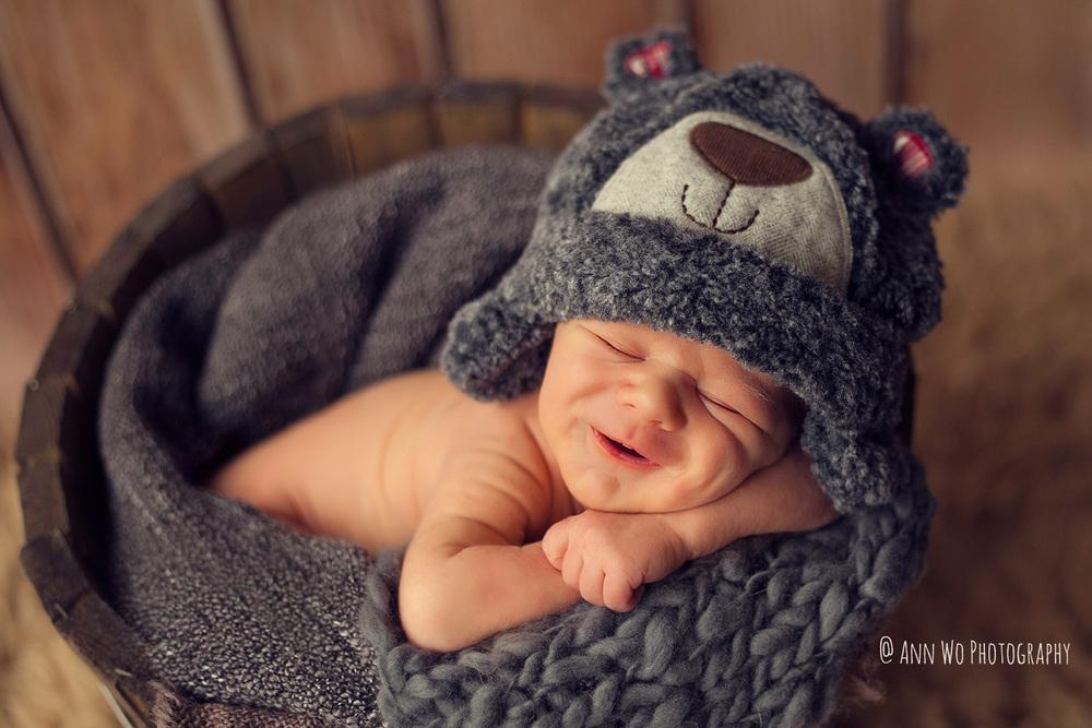 smiling-newborn-photographer-ann-wo-london.jpg