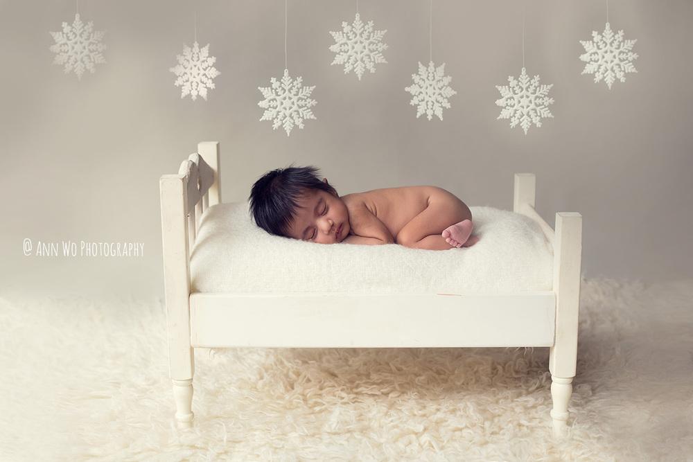 newborn baby photo with snowflakes