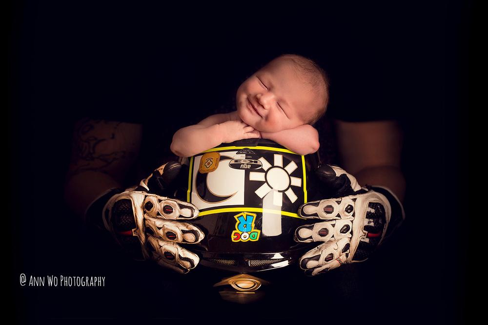 newborn in biker helmet ann wo london baby photographer