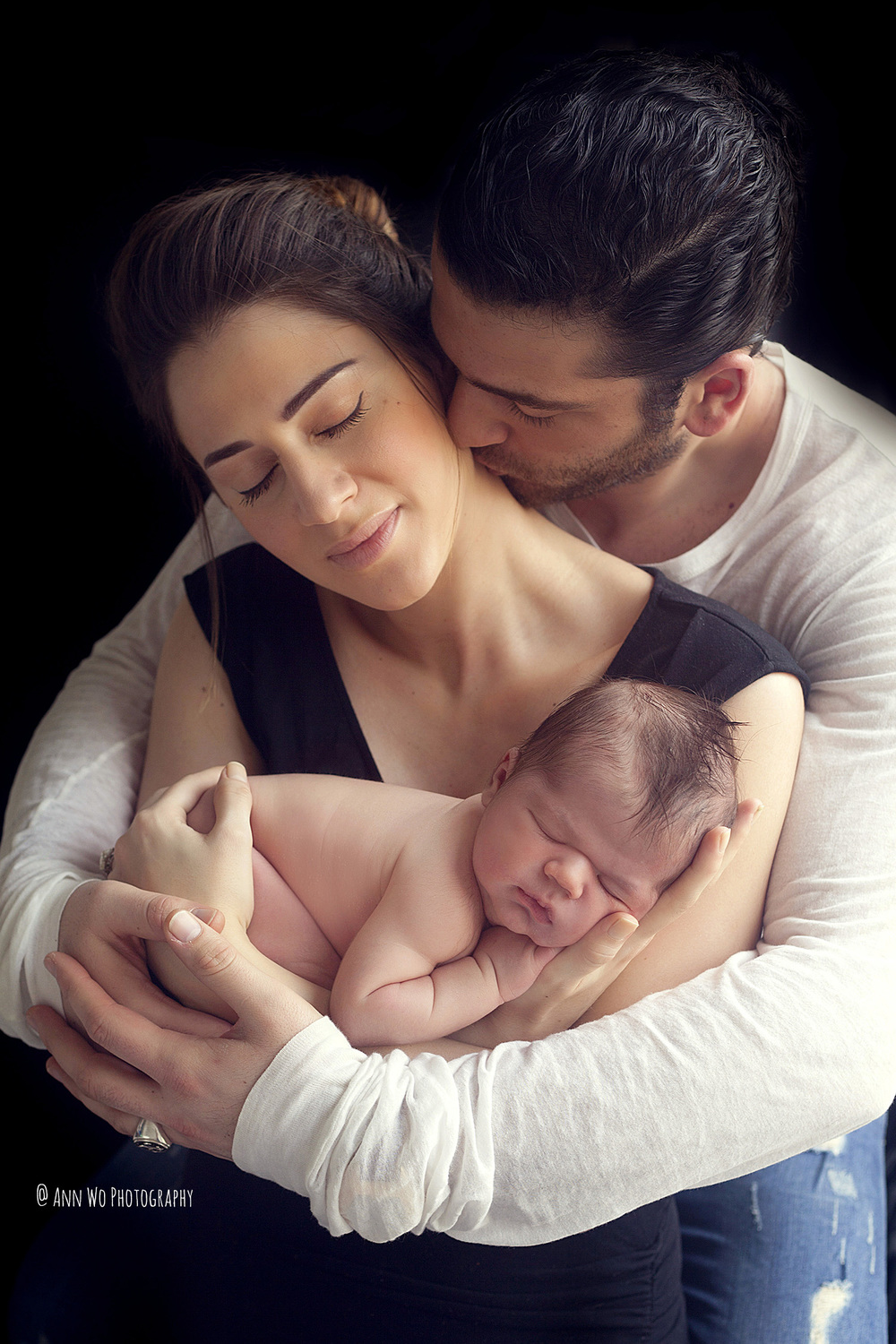 newborn baby and parents black background ann wo photography uk