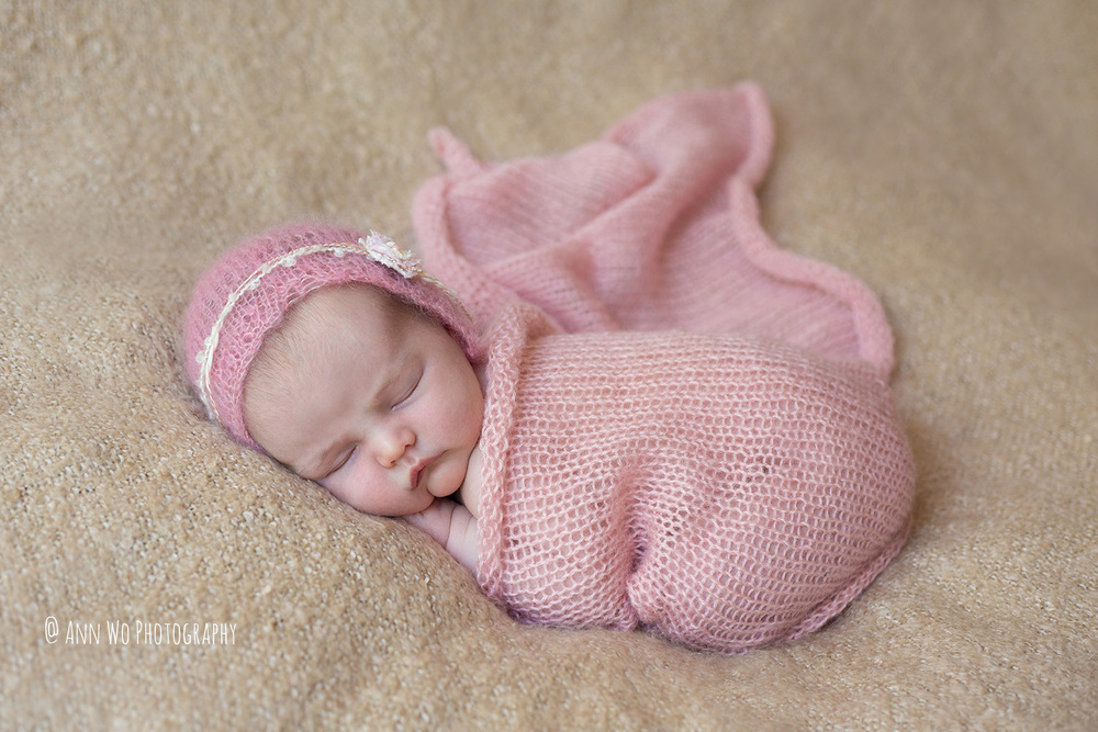 newborn baby girl light pink knitted wrap and hat ann wo photography