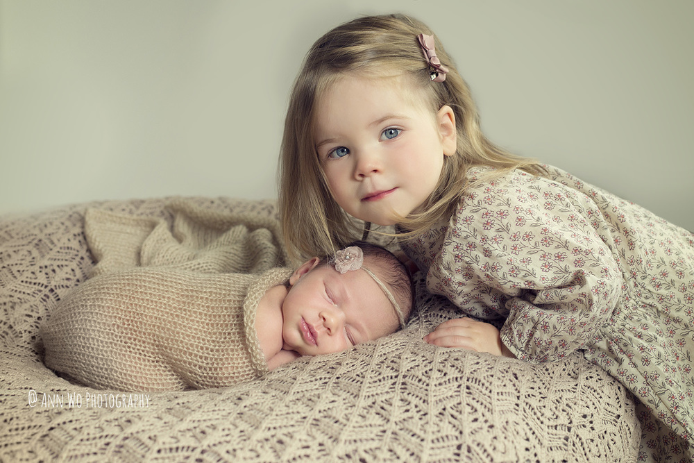 sisters- newborn baby girl and toddler