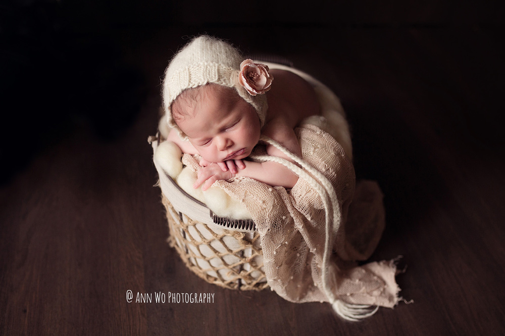 baby photography in Maidenhead Berkshire by Ann Wo newborn photo in basket