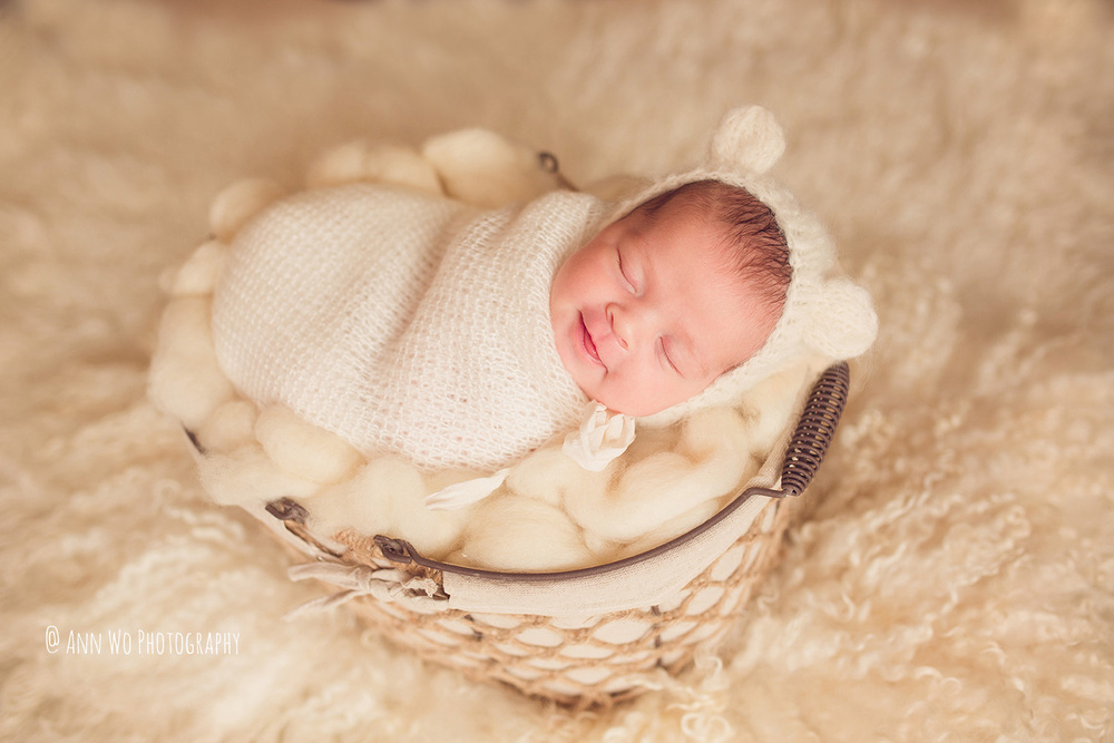 newborn photography training cream set up smiling baby by Ann Wo in London