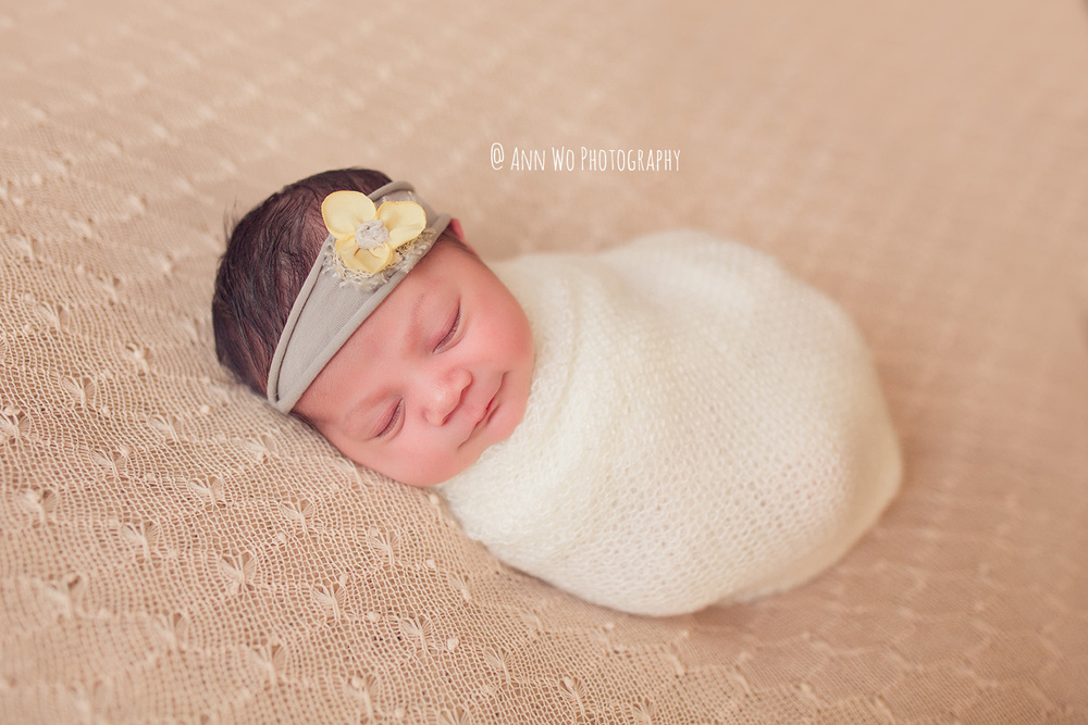 newborn baby photographer ann wo london uk posing stretchy knit fabric beanbag cream