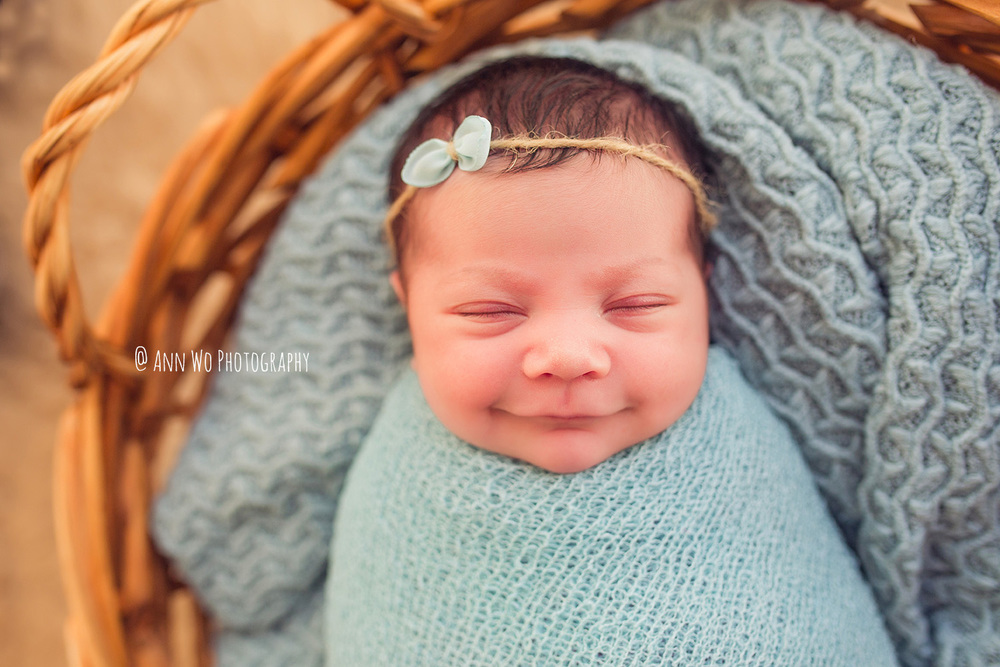 smiling newborn baby girl - ann wo photography london