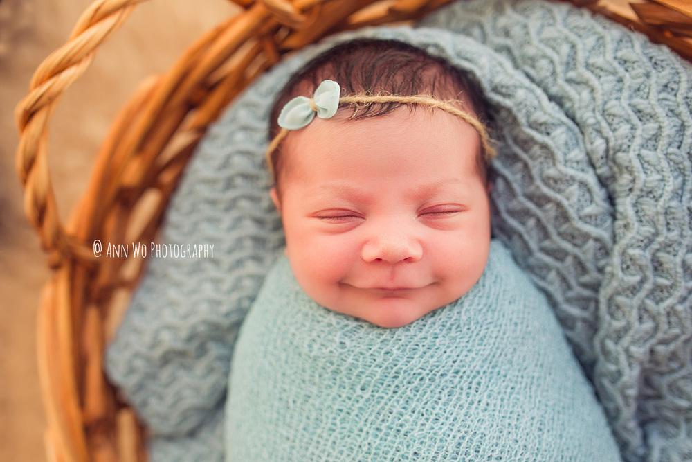 smiling newborn baby girl - ann wo photography london